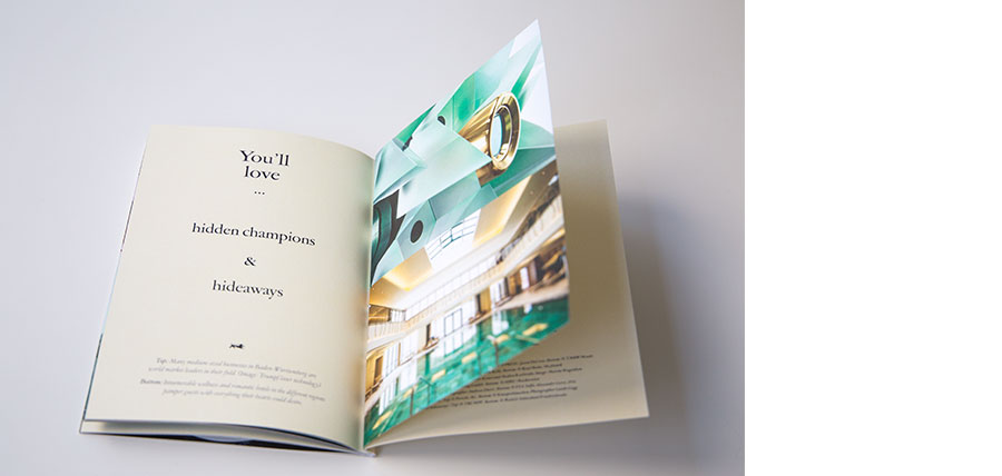 Aufgeschlagene Imagebroschüre. Auf einer Seite ist die Headline 'You'll love ... hidden champions & hideaways' zu lesen. Auf der anderen Seite sieht man das Bild eines Lasers von Trumpf und darunter das Bild eines Hallenbads in einem Hotel.